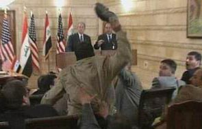 Muntadar al-Zaidi throwing shoe at George W. Bush